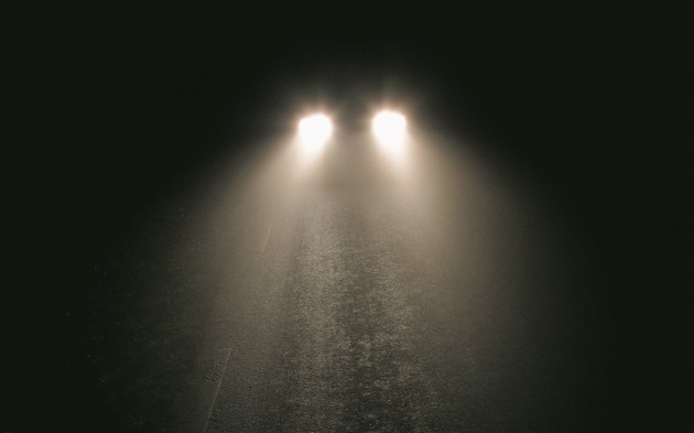 Automobile Lights on Foggy Night