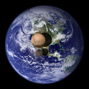 La Terre, Pluton et Charon représentés à la même échelle. Photo Nasa.