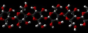 Structure atomique de la cellulose. En rouge, l'oxygène, en blanc, l'hydrogène et en gris, le carbone (Daniel Jolivet, Domaine public).